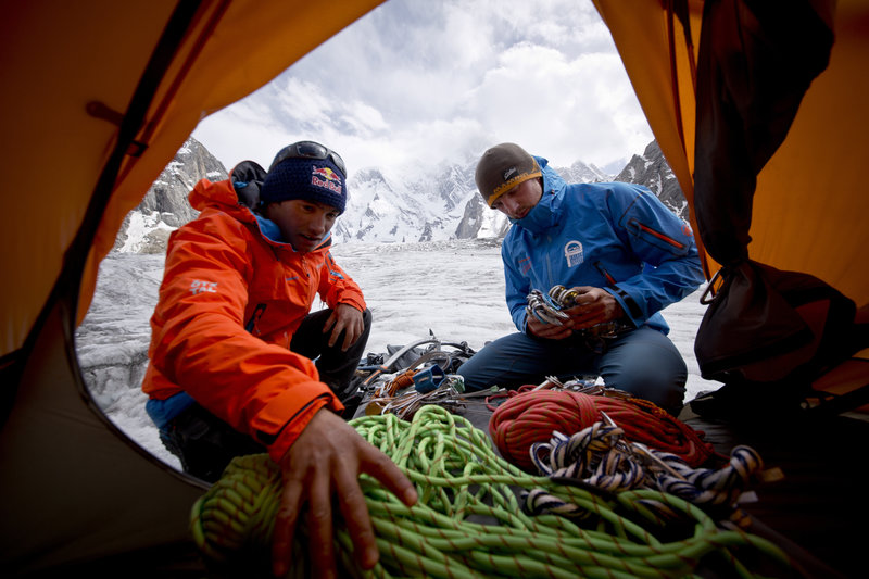 David Lama and Peter Ortner packing for an attempt on Masherbrum in Pakistan during the 2013 expedition.